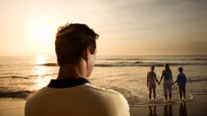 man watching family sunset